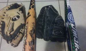 Baseball gloves and bats for Sale in Phoenix, AZ