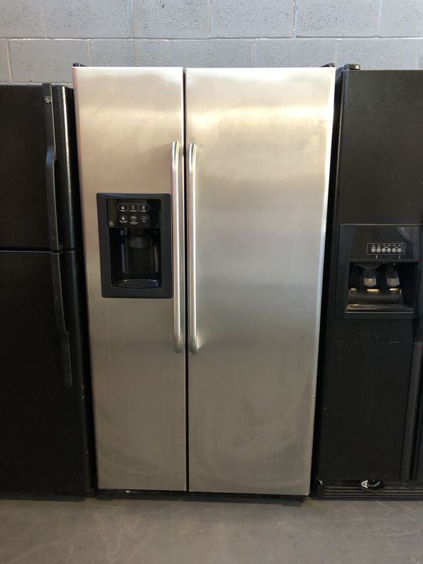 36by69 GE FRIDGE SIDE BY SIDE STAINLESS STEEL WITH WARRANTY