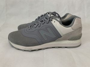 New Balance 574, 7.5US Light Grey, Crafted with a lightweight and breathable, leather heel, and a rubber outsole. for Sale in Port St. Lucie, FL