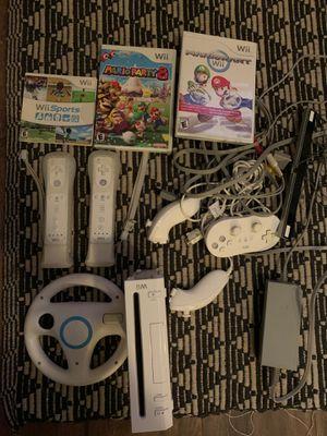 Wii Console + Remote Controllers + Nunchuks + steering wheel + Mario Kart + Mario Party 8 for Sale in San Diego, CA