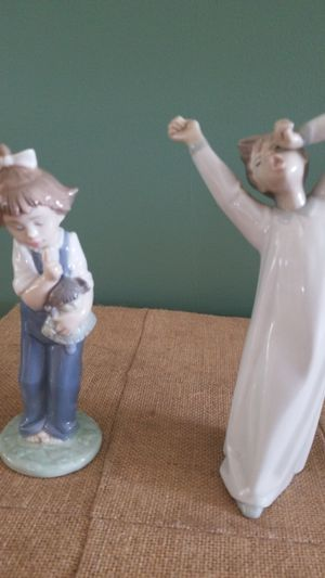 Lladro boy and Nao girl figurines. for Sale in Boynton Beach, FL