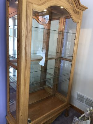Maple wood and glass curio cabinet for Sale in Andover, MN