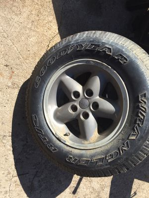 Jeep wrangler spare tire and wheel 215. 75. 15. for Sale in Mentor, OH