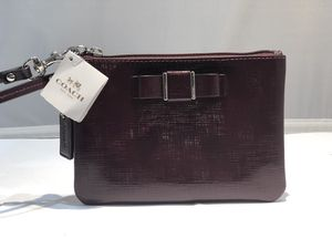 Burgundy Coach Wristlet (phl033264) for Sale in Philadelphia, PA