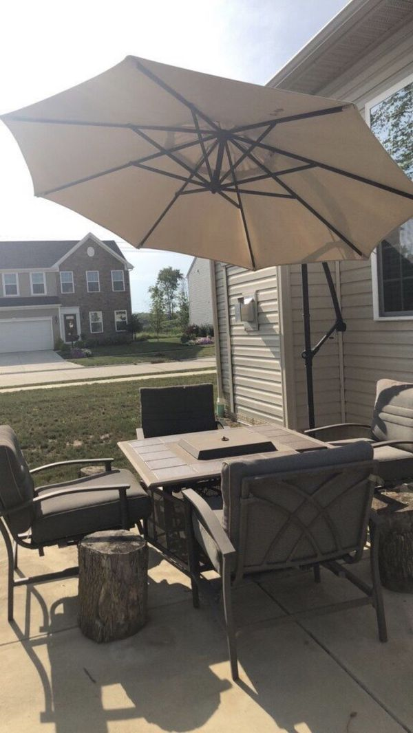Patio set with grill and umbrella