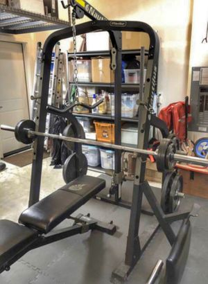 Nautilus squat rack weights bar bench for Sale in Seattle, WA
