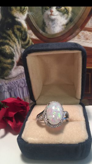 Oval Fire Opal with a frame of white sapphires set on .925 sterling silver designer band with little channel set sapphires sz8 for Sale in Northfield, OH