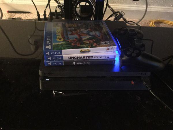 Consola ps4. 1tb con 3 video juegos