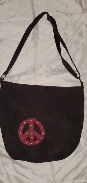 HOBO CROSS BODY LARGE SIZE SACHEL BAG WITH A PEACE AND LOVE LOGO. AND ADJUSTABLE SHOULDER STRAP. for Sale in Lynwood, CA