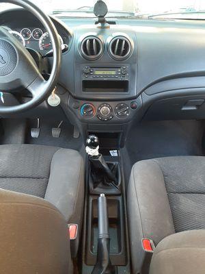 Chevi aveo 2014 estándar 4 puertas Nacional de agencia muy económico de gasolina a/c for Sale in Phoenix, AZ
