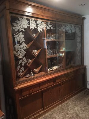ANTIQUE VINTAGE FULL WALL CHINA CABINET WALL UNIT SOLID OAK CUSTOM MADE WITH CUSTOM ETCHED GLASS WITH MATCHING GLASSES. BEST OFFER TAKES for Sale in Las Vegas, NV