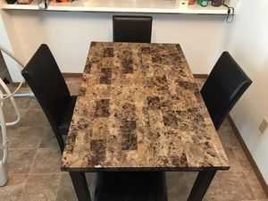Very nice marble like dining room table seats family of 4 for Sale in Scottville, MI
