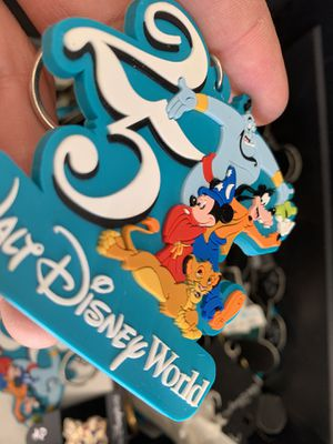 Box full of old Disney key chains and pins. for Sale in Apopka, FL