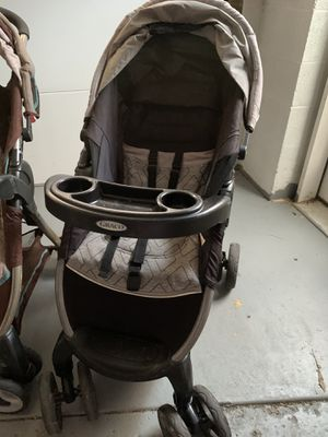 Two Graco strollers and click connect base for Sale in Parma, OH
