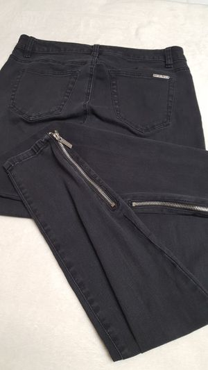 Michael Kors stretch Jeans with ankle silver zippers in Sz 4 super soft, great condition. black color. for Sale in Covington, KY