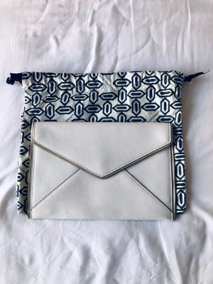 """Rebecca Minkoff Stylish White Scratch-Resistant Saffiano Leather """"Leo"""" Clutch with Dust Bag. Magnetic-snap flap, interior pockets for storage for Sale in Arlington, VA"""