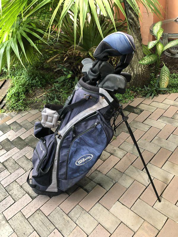 Beginner set of Wilson golf clubs.