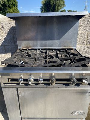 Restaurant stove. Missing some part the holds the grates for Sale in Sylmar, CA