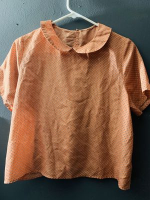 Orange shirt with open back and bows for Sale in Long Beach, CA