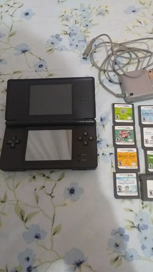 Nintendo ds lite . with charger . and 8 games included for Sale in Adelphi, MD