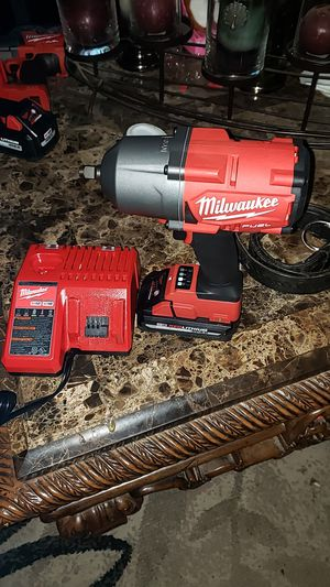 M18 1/2 inch impact hide torque 1400 we 3.0 battery and charger for Sale in Hanford, CA