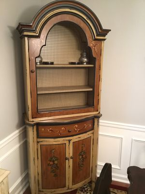 3 WOOD TONES WITH DECORATIVE PAINTING CABINET. LIKE NEW. AN BE USED IN ANY ROOM. HAS SHELVES, ONE DRAWER AND 2 DOORS FOR STORAGE. VERY WELL MADE AN for Sale in Dalton, GA