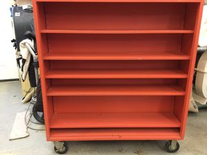 Red metal cart with selves, double sided that moves on wheels for Sale in Gray, ME