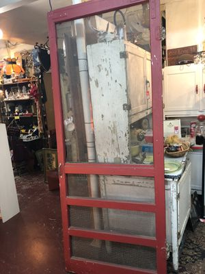 32 3/8x1x81 antique vintage porch screen red door. Bought in Smithville Texas. Has hinges and hooks. 85.00 212 north Main Street Buda furniture sterl for Sale in Buda, TX