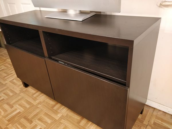 """Like new TV stand for big TVs with 2 doors and adjustable shelves in great condition. L47.5""""*W16""""*H29.5"""""""