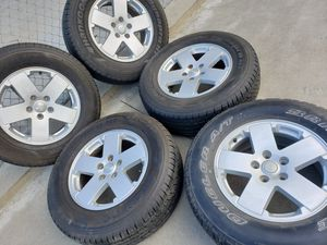 """JEEP SAHARA 18""""INCH WHEELS WITH HANKOOK 255/70/18 TIRES for Sale in Ontario, CA"""