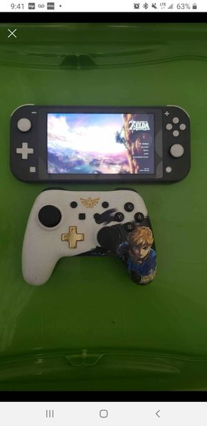 Grey Nintendo switch lite with Zelda downloaded and zelda controller for Sale in Winter Springs, FL