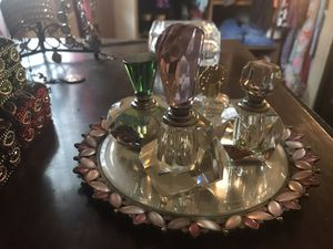 Antique style perfume bottles on glass plate for Sale in Statesville, NC