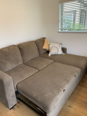 L Shaped couch - turns into queen bed for Sale in Los Alamitos, CA
