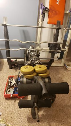 Weight Bench with 1 inch plates, 1 inch barbell, 1 inch curl bar for Sale in Clifton,  VA