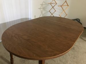 Wooden dining g table with 2 extension leaves for Sale in Peoria, IL