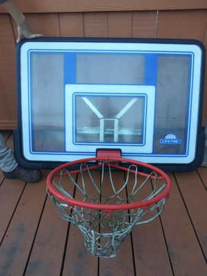 Lifetime brand basketball hoop with backboard. for Sale in St. Louis, MO