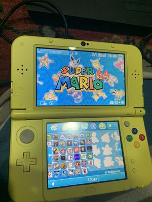 New 3ds xl yellow Pikachu edition with 10,000 games for Sale in Redwood City, CA