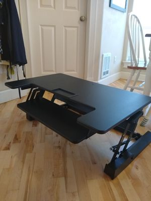 Sit stand desk converter with airlift for Sale in Seattle, WA
