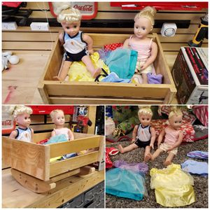 American girl type dolls. With Disney outfits-with homemade rocking cradle for Sale in Renton, WA