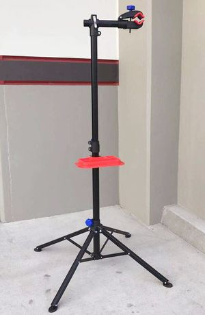 New in box height adjustable 41 to 75 inch bicycle bike repair stand cleaning 66lbs capacity change tire stand with stabilizer bar for Sale in Whittier, CA