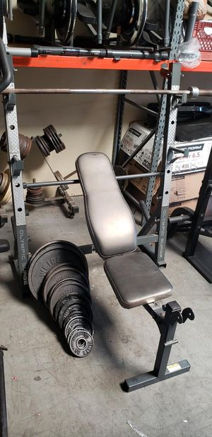 Bench press/ squat rack with weights for Sale in Anaheim, CA