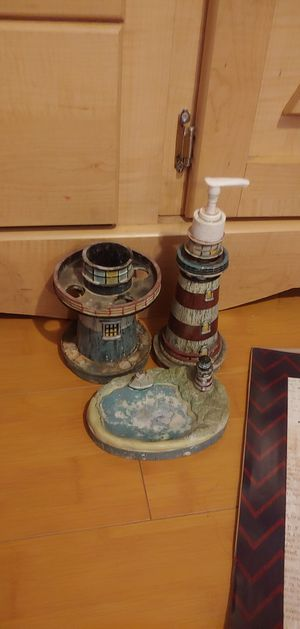 Nautical, light house decor for bathroom. Needs a wash but good condition. Light house soap dispenser, soap tray and toothbrush holder. for Sale in Pomona, CA