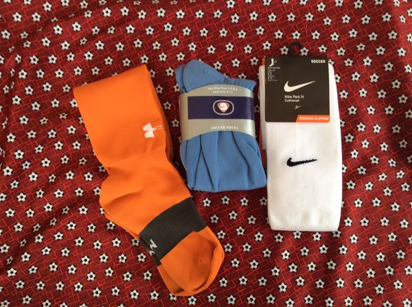Nike and under armour soccer socks. Medium