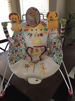 Bouncy seat with vibration, only used 2 times. 1 pack of size 1 diapers (46) for Sale in Bakersfield, CA
