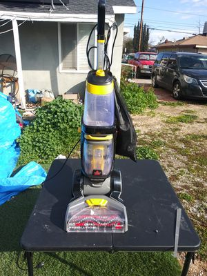 Nice deal on a Bissell ProHeat 2X Revolution carpet cleaner for Sale in Moreno Valley, CA