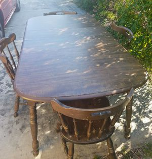 Wooden dining table with 4 chairs comes with 2 leaves to make table bigger, scratches on chairs but sturdy 70x37x30high with leaves 49x37x30 without for Sale in Ocean Ridge, FL