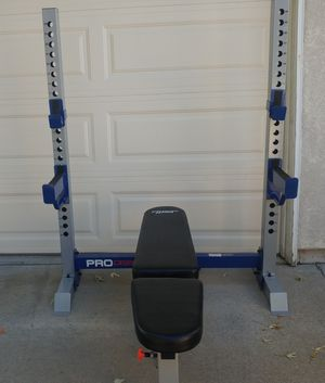 Bench press squat rack with safeties, bar, 100 lbs plates for Sale in Elk Grove, CA