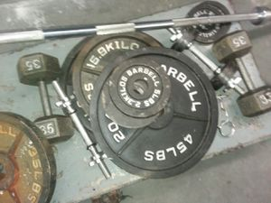 250 lb Olympic set with bar plus extras including dumbbells and bench heavy duty for Sale in Virginia Beach, VA