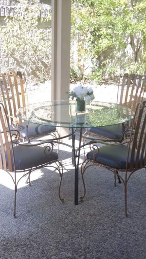 Wrought Iron table w glass top and 4 new upholstered leather chairs/indoor dining room/outdoor patio set for Sale in Chino Hills, CA