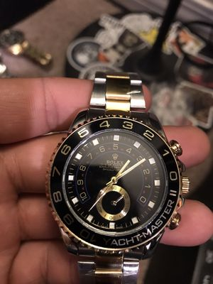 Men's black and gold watch for Sale in Riverside, CA